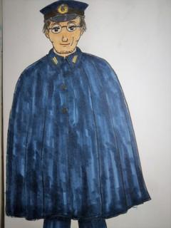 マント型雨衣の海崎君